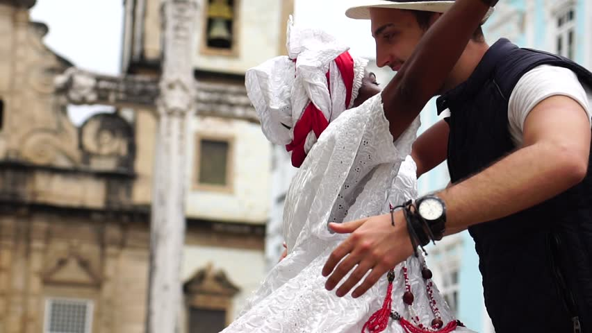 Brazilian Woman Giving Her Necklace to Tourist in Salvador, Bahia