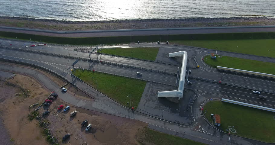 Entry into the vehicular tunnel under ship passage in Finland Gulf. City the ring road along Dam near Kronstadt town. St. Petersburg, Russia