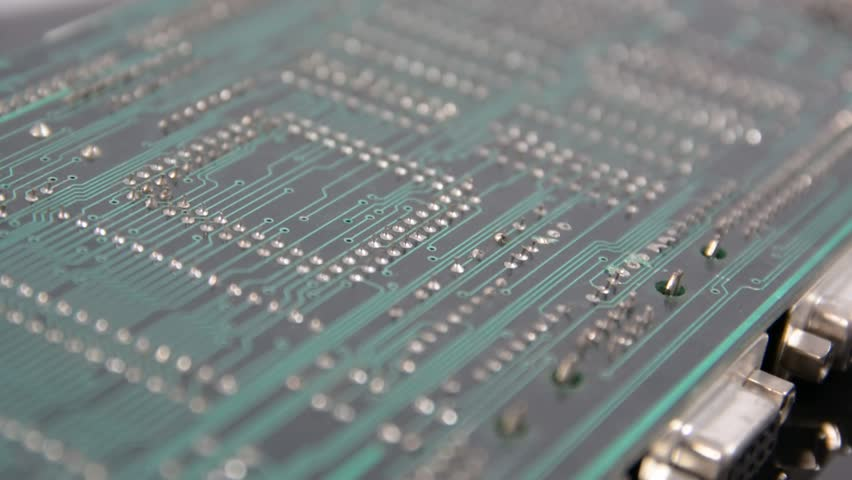 Small electronic board with circuits and various components, on dark background | Shutterstock HD Video #31587133