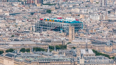 Top view of Paris skyline from above timelapse. Main landmarks of european megapolis with Centre of Pompidou. Bird-eye view from observation deck of Montparnasse tower. Paris, France