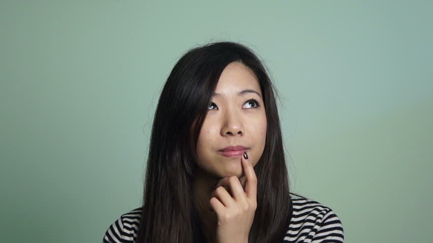 Asian woman thinking at something