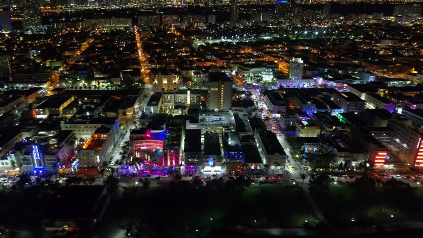 Lateral aerial shot Ocean Drive Miami Beach night 4k