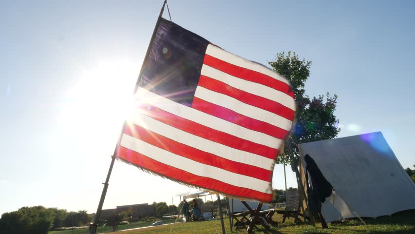 Civil War American Flag Blowing in the Wind Isolated on Blue Sky #31651681