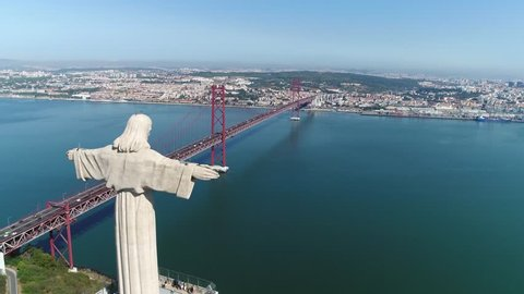 Aerial bird view of Sanctuary of Christ the King in Portuguese Santuario de Cristo Rei Catholic monument and shrine dedicated to Sacred Heart of Jesus Christ overlooking city of Lisbon Portugal 4k