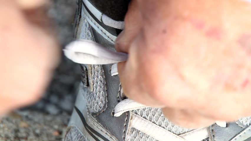 Tying a shoe string