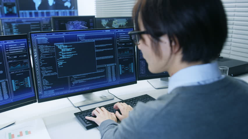 Technical Controller/ Operator Working at His Workstation with Multiple Displays Showing Graphics. Possible Power Plant/ Airport Dispatcher/ Dam Worker/ Data Center/ Government Surveillance/ Space. | Shutterstock HD Video #31712065
