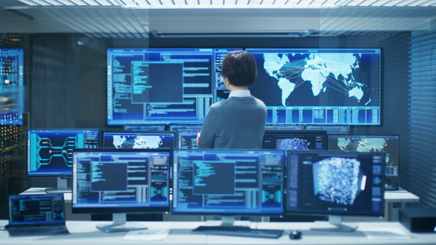 In the System Control Room Smart Engineer Turns and Makes Thinking Gesture. High-Tech Facility Has Multiple Monitors with Graphics. Shot on RED EPIC-W 8K Helium Cinema Camera. | Shutterstock HD Video #31712095