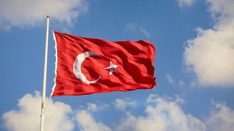 Turkish Flag waving in the wind over blue sky with white clouds. Slow Motion, Loop, HD 1080p video. Flag of Turkey; A red flag featuring a white star and crescent often called as moon-star. Ayyildiz