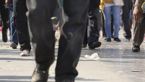 Low angle camera angle showing lower legs of crowd of people in Mexico City walking to the basilica of the Virgin of Guadalupe on December 12, 2012