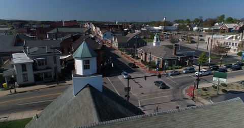 A day dolly aerial establishing shot of the small town of Salem, Ohio's business district.