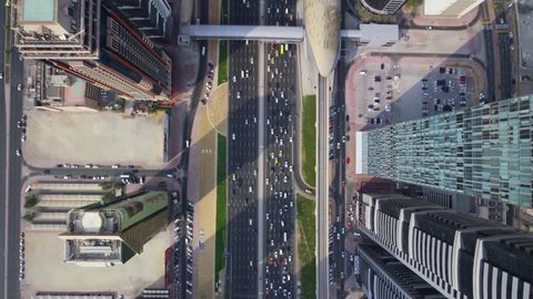 Excellent top aerial drone view on long busy highway road and modern skyscraper building in urban Dubai city panorama