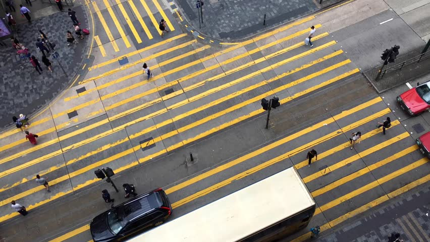 Time lapse video of the pedestrian crossing in Kong Kong. It is a top view from Chungking Mansions famous with its budget accommodation   Shutterstock HD Video #31796518