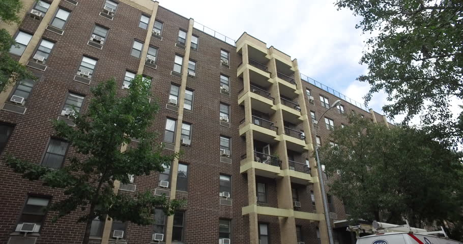 Exterior large apartment building establishing shot in New York City. Affordable housing complex or middle class income family real estate rental. 4k DX stock video
