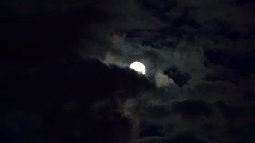 Clouds passing by moon at night. Full moon at night with cloud real time. Details on surface visible