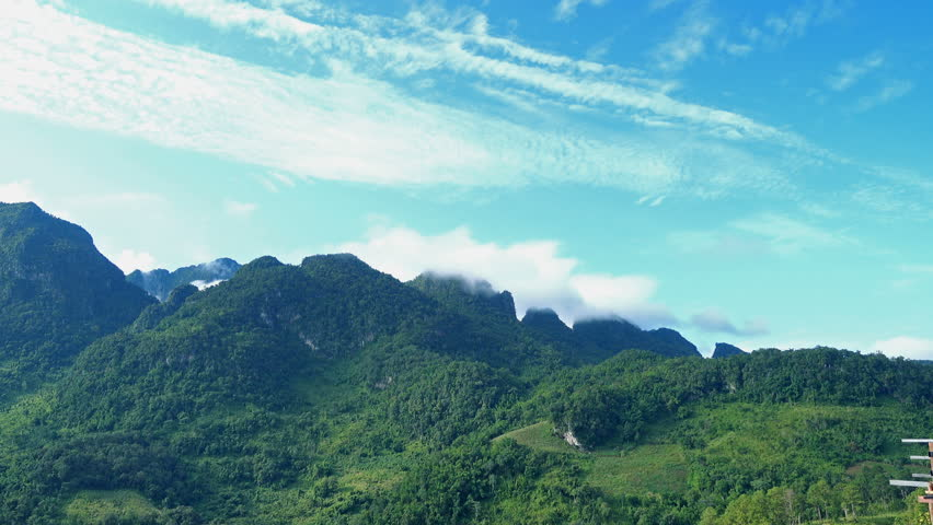 Beautiful scenery of green tropical mountain range, clouds and blue sky in summer at Doi Laung Chiang Dao, Chiang Mai, Thailand | Shutterstock HD Video #31858822
