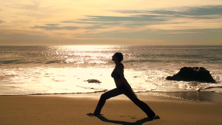 Yoga on the beach at sunset - V2 Warrior 3 HD 1080i
