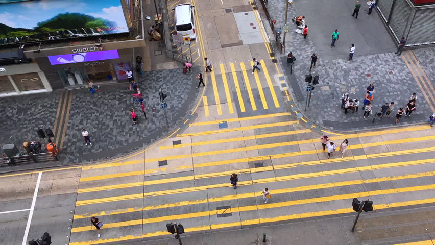 HONG KONG, CHINA - SEPTEMBER, 14, 2017: The bird view of the traffic and pedestrians in the downtown of Hong Kong, China  | Shutterstock HD Video #31877575