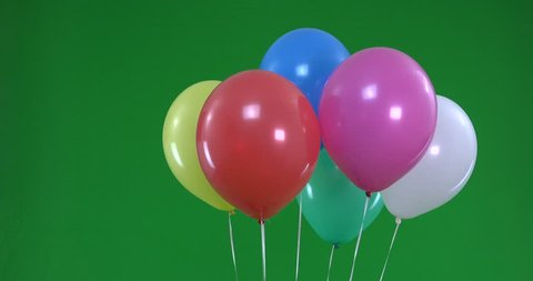Green screen of colorful Balloons that rise