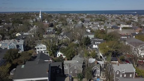 Nantucket Historic Village close AERIAL. Nantucket, a tiny, isolated island off Cape Cod, Massachusetts, is a summer destination with beaches. It's marked by unpainted cedar-shingled buildings