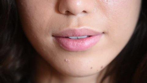 Young woman mouth detail speaking concept moving lips vocal message