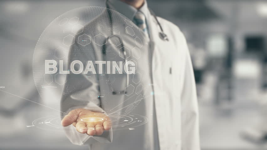 Doctor holding in hand Bloating