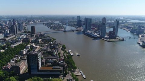 Aerial of Rotterdam city in Netherlands in South Holland its history goes back to 1270 when dam was constructed in the Rotte river this city is major logistic and economic centre Europe's largest port