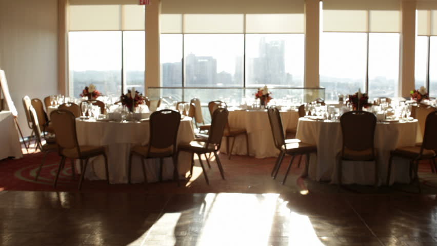 A wedding reception room with blinds closing