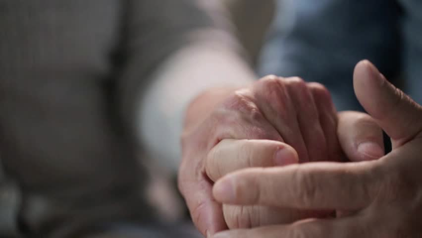 relationships, old age and people concept - senior couple holding hands