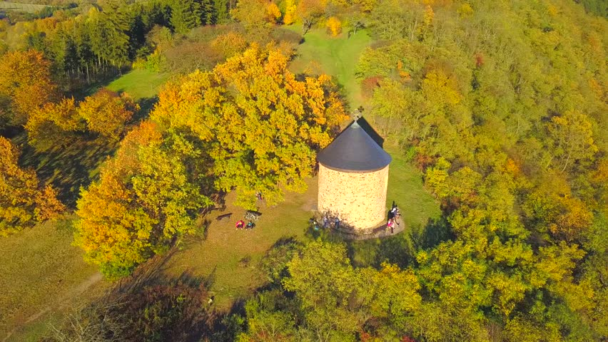 Aerial view of rotunda of St. Peter and Paul in Stary Plzenec. Rotunda was built in 10th century, it is one of the oldest christian landmark in Czech republic, European union. Camera flight over.