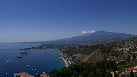 The town of Taormina in Sicily with the mount Etna in the background. Italy