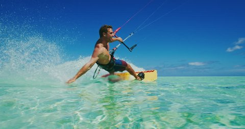 Kitesurfing on tropical island with amazing blue water