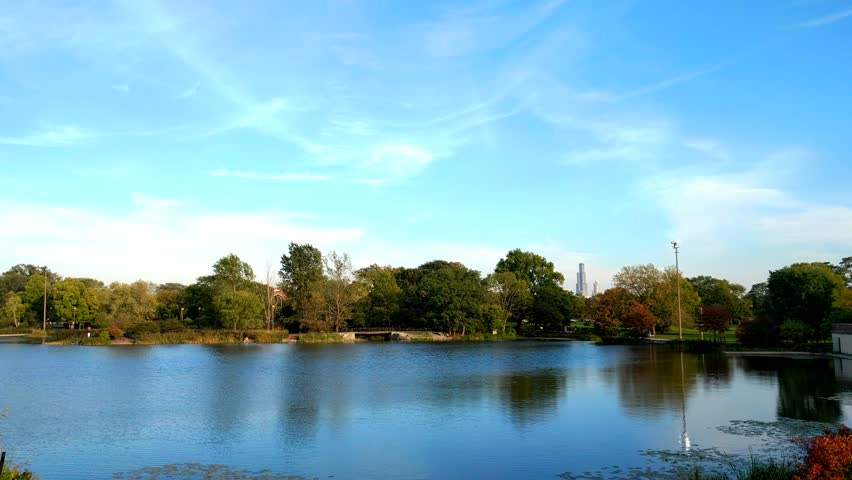 Humboldt Park Lagoon. A view of the lagoon in Humboldt Park. The tree scape and Willis Tower are in the distance.
