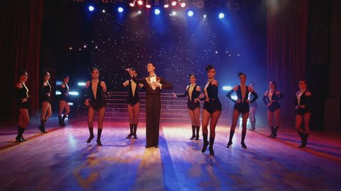 A stage show at a cabaret features dancers