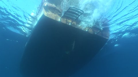 propeller of a boat working turning underwater