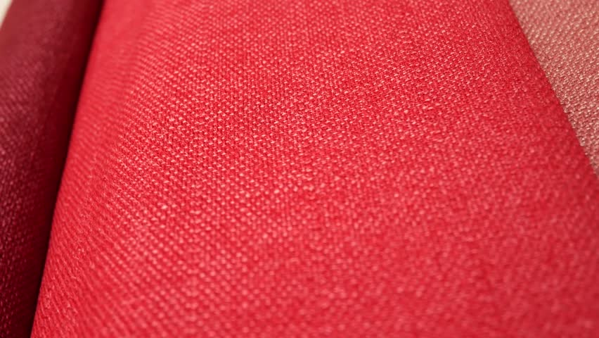 e30ab2d3 Fabric Samples Of Different Colors In Move Are Spinning And Rotation:  Purple And Dark Red Colors. Textile Textures Fabric