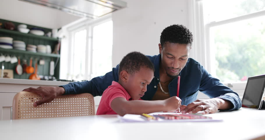 Father helping Son with school work