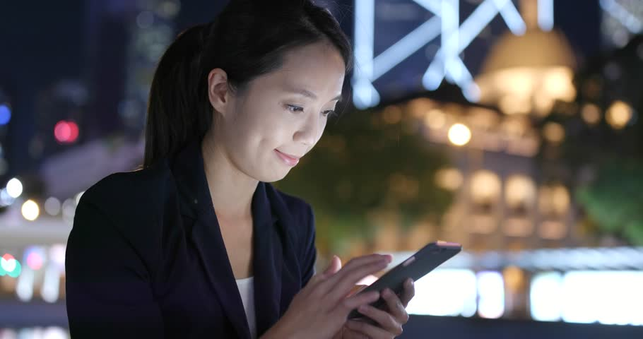 Businesswoman use of cellphone at night  | Shutterstock HD Video #32037445