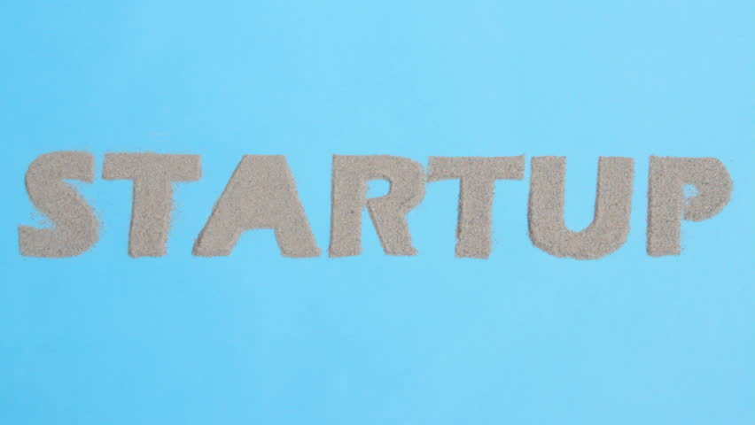"""inscription """"startup"""" from sand appears on the blue screen   Shutterstock HD Video #32054644"""