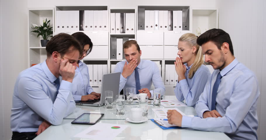 Overworked Team of Business Staff Concentration Issues Problem Conference Room | Shutterstock HD Video #32064625