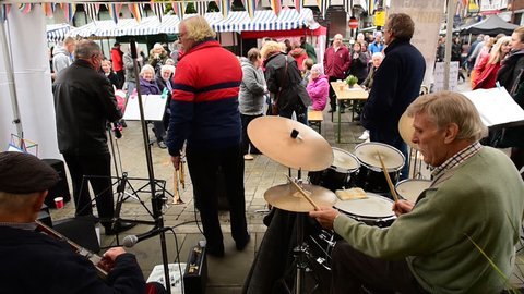 """MACCLESFIELD, UK. OCTOBER 30, 2016.Jazz band playing live at the popular """"Treacle Market"""", a traditional market selling food,drink,antiques and craft items."""