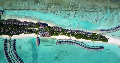 v09488 five 5 star resort water bungalows in Maldives with drone aerial flying view on white sand beach on tropical island