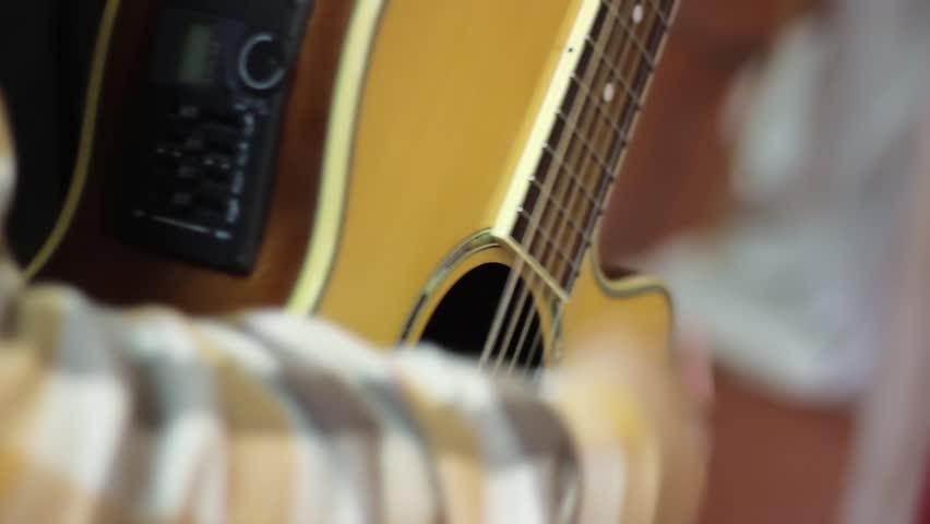 Guitar play. man plays on vintage guitar | Shutterstock HD Video #32137105