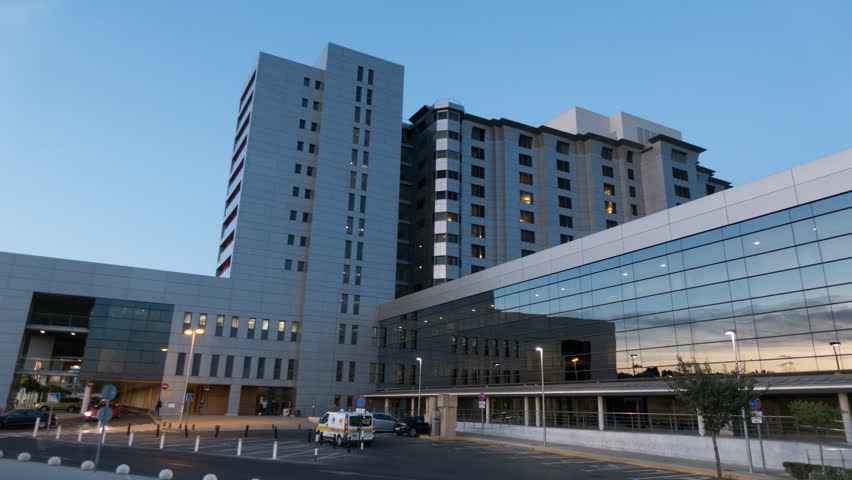 Health Care Modern Hospital Exterior Building. Day to night Time Lapse