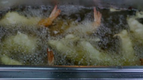 4K footage, Chef hand cooking fried prawn shrimp, tempura Japanese food,in Kitchen
