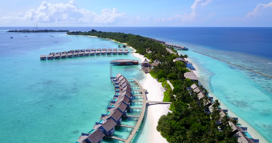 v09540 five 5 star resort water bungalows in Maldives with drone aerial flying view on white sand beach on tropical island