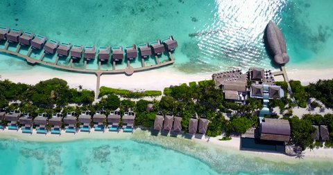 v09573 five 5 star resort water bungalows in Maldives with drone aerial flying view on white sand beach on tropical island