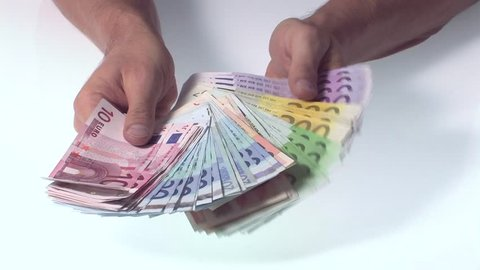 hand holds many euro bills