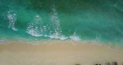 v11269 waves water texture breaking and crashing with drone aerial flying view of aqua blue and green clear sea ocean