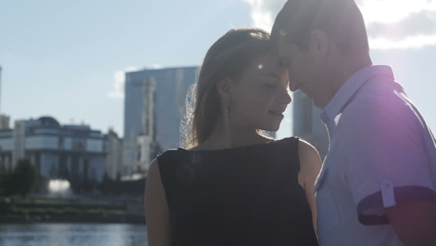 Young man approach woman kiss her lips silhouette stock footage couple embracing in sunlight hd stock video clip ccuart Gallery