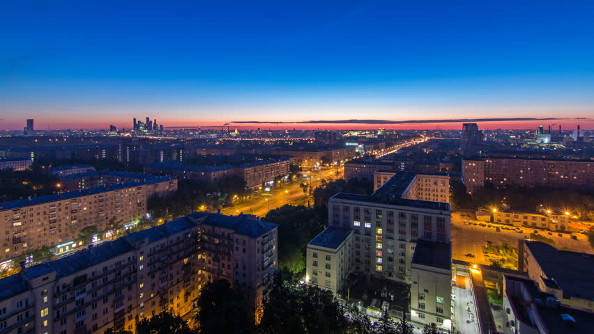 Residential buildings on Leninskiy avenue, Stalin skyscrapers and panorama of city before sunrise night to day transition timelapse in Moscow, Russia. Traffic on the road. Aerial view from rooftop | Shutterstock HD Video #32309245